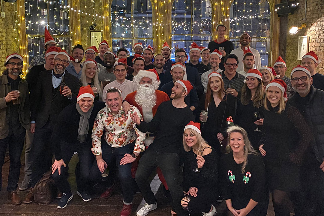 Agency owners networking at a Christmas party organised by The Agency Collective